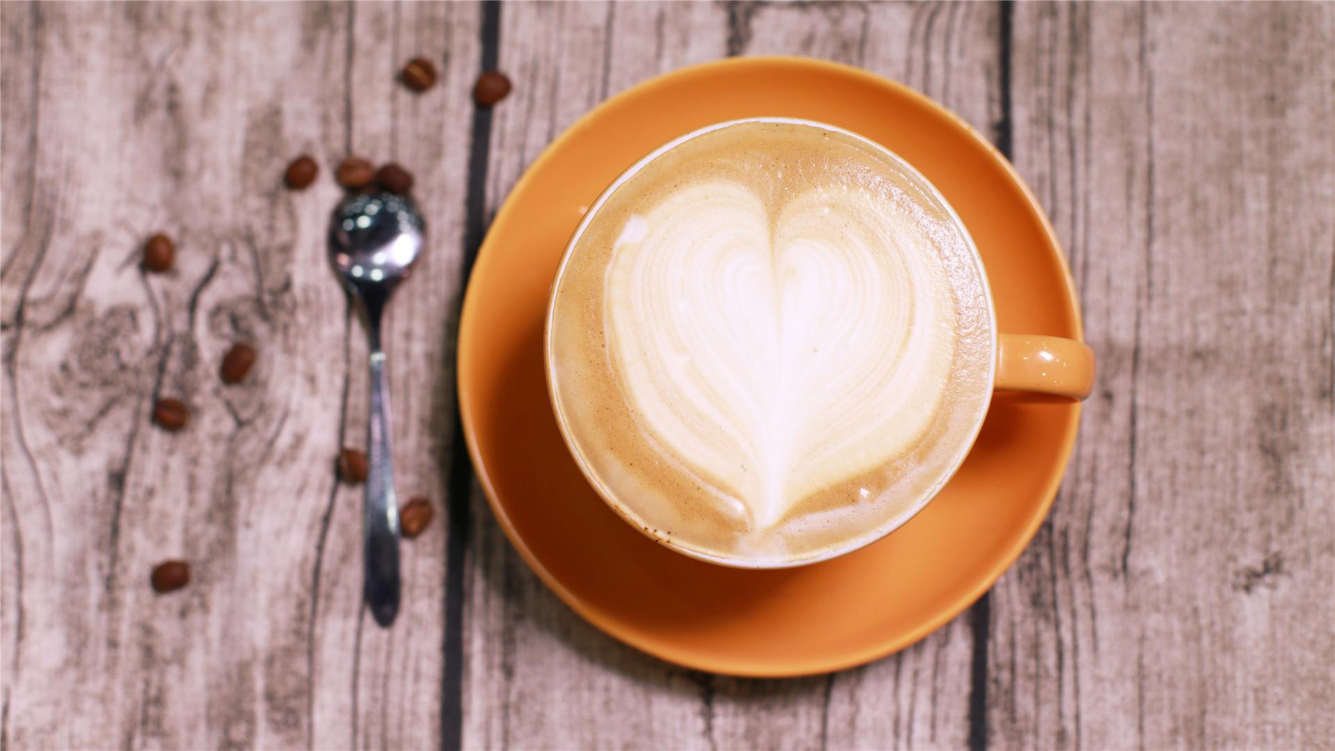 简单创意的咖啡拉花蜘蛛网桌面壁纸图片